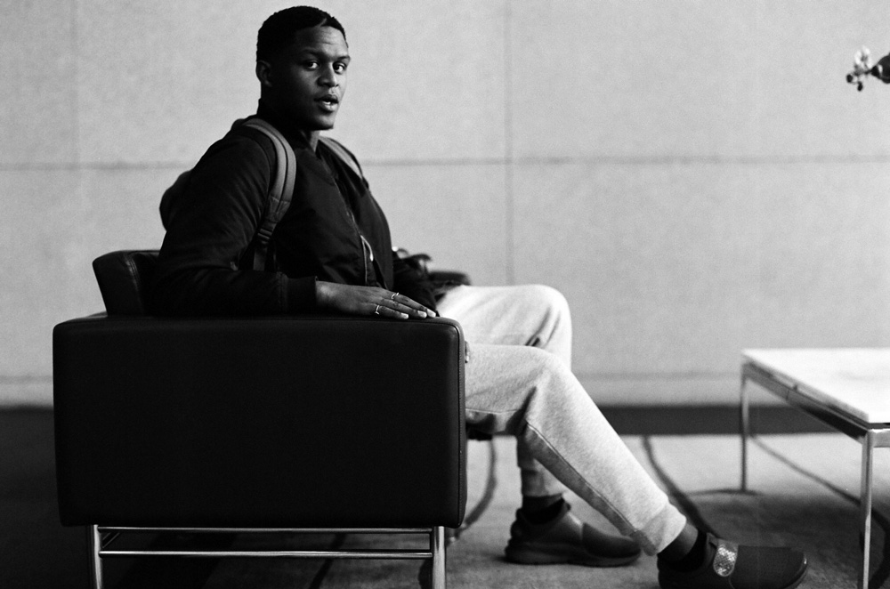 black and white photograph of Quinnton Harris sitting in a chair