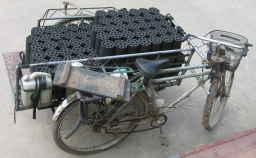 rickshaw load of cylindrical briquettes