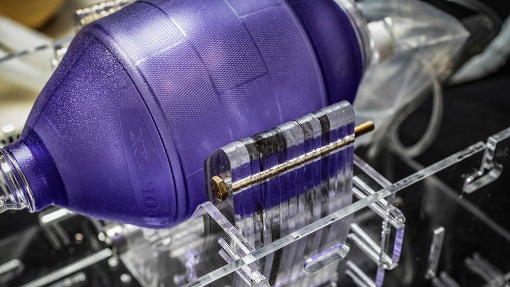 A closeup shot of the purple emergency resuscitation bag on a ventilator prototype