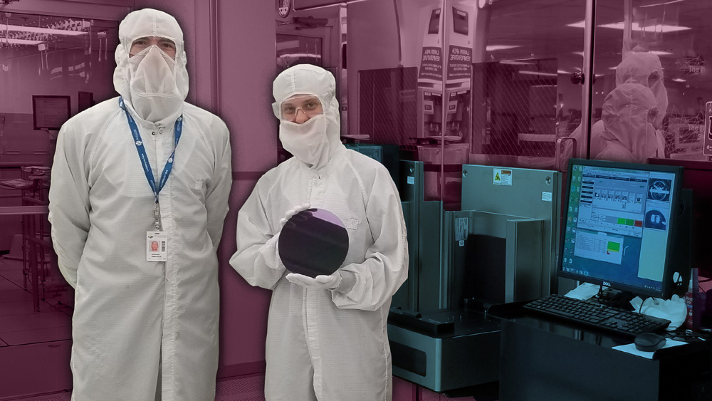 two researchers in lab holding silicon